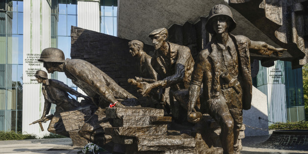 Poland, Warsaw, Monument to the Warsaw Uprising, another section of the monument showing a group of Polish insurgents actively engaged in combat.