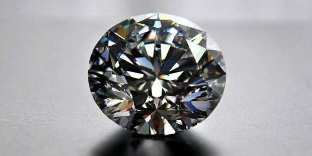 A close-up view of the main 51.38-carat round-cut diamond, the Dynasty, from Russian diamond miner Alrosas Dynasty polished diamonds collection in Moscow on August 3, 2017.The collection of five polished stones was manufactured from a 179-carat Romanovs rough diamond, extracted at the companys Nyurbinskaya kimberlite pipe in Russia's far northeast region of Yakutia in 2015. Alrosa plans to sell the whole collection in one set at a special online auction in November with the starting price not le