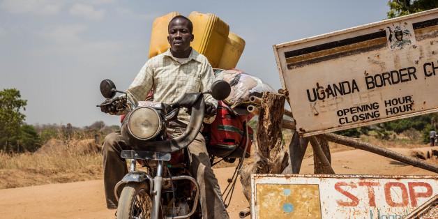 MOYO, UGANDA - FEBURARY 05: A man carrying luggage on his motorbike crosses the border at a formal crossing point on Feburary 05, 2017 in Moyo, Uganda.  PHOTOGRAPH BY Natalia Jidovanu / Le Pictorium / Barcroft Images  London-T:+44 207 033 1031 E:hello@barcroftmedia.com - New York-T:+1 212 796 2458 E:hello@barcroftusa.com - New Delhi-T:+91 11 4053 2429 E:hello@barcroftindia.com www.barcroftimages.com (Photo credit should read Natalia J/LePictorium/Barcroft / Barcroft Media via Getty Images)