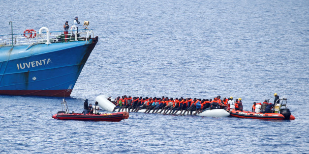 "Migrants on a dinghy are rescued by German NGO Jugend Rettet ship ""Juventa"" crew in the Mediterranean sea, off the coast of Libya June 18, 2017. Picture taken June 18, 2017. REUTERS/Stefano Rellandini"