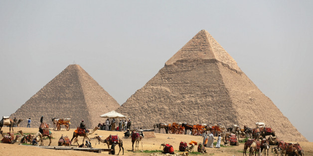 A group of camels and horses stand idle in front of the Great Pyramids awaiting tourists in Giza, Egypt, March 29, 2017. REUTERS/Mohamed Abd El Ghany