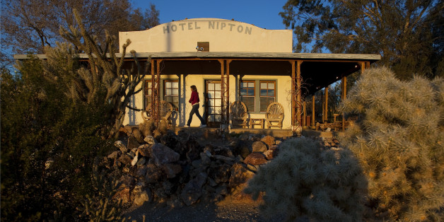 Warm late afternoon light falls on the front porch of the historic Hotel Nipton in this remote Mojave Desert town just two miles from the Nevada border. The remote town has turned high–tech with its new 80–kilowatt solar installation from Skyline Solar, Inc. The solar system provides 85 percent of the town's energy needs.  (Photo by Gina Ferazzi/Los Angeles Times via Getty Images)
