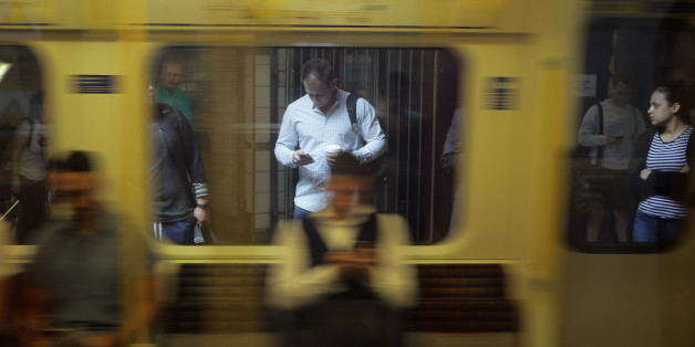 A man looks at his phone in the underground tube in London, Britain June 16, 2017. REUTERS/Kevin Coombs