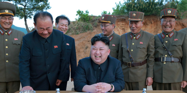 FILE PHOTO - North Korean leader Kim Jong Un reacts during the long-range strategic ballistic rocket Hwasong-12 (Mars-12) test launch in this undated photo released by North Korea's Korean Central News Agency (KCNA) on May 15, 2017. KCNA via REUTERS/File Photo   REUTERS ATTENTION EDITORS - THIS IMAGE WAS PROVIDED BY A THIRD PARTY. REUTERS IS UNABLE TO INDEPENDENTLY VERIFY THIS IMAGE. NO THIRD PARTY SALES. SOUTH KOREA OUT.