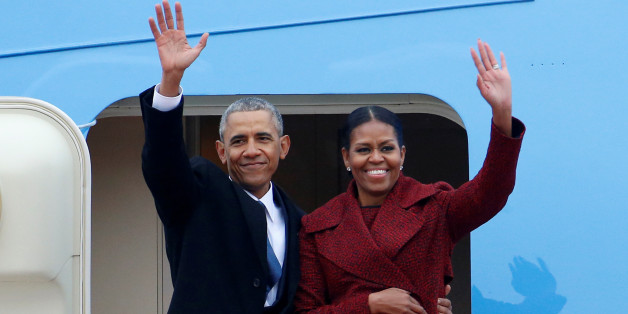Former president Barack Obama waves with his wife Michelle as they board Special Air Mission 28000, a Boeing 747 which serves as Air Force One, at Joint Base Andrews, Maryland, U.S. January 20, 2017.   REUTERS/Brendan McDermid
