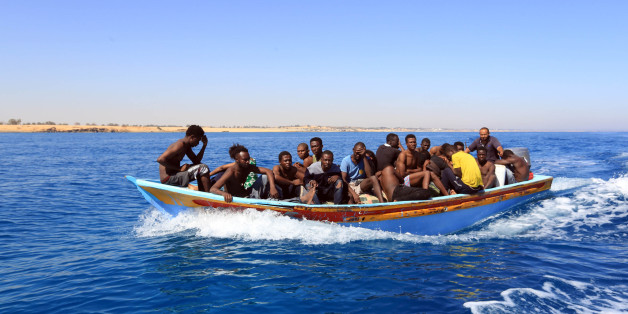 Libyan coastguards help rescue illegal immigrants attempting to reach Europe off the coastal town of Guarabouli, 60 kilometres (36 miles) east of the capital, on July 8, 2017.Thirty-five migrants, including seven children, were feared drowned after their inflatable craft sank off the Libyan coast, the coastguard said. Eighty-five migrants, including 18 women, were rescued with the help of fishermen who alerted the coastguard. / AFP PHOTO / MAHMUD TURKIA        (Photo credit should read MAHMUD TU