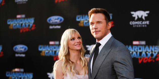 """Chris Pratt (R) poses with his wife Anna Faris as they attend a premiere of the film """"Guardians of the galaxy, Vol. 2"""" in London April 24, 2017. REUTERS/Hannah McKay"""