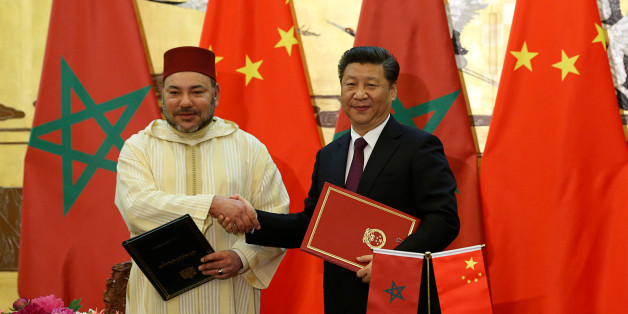 China's President Xi Jinping (R) and Moroccan King, Mohammed VI, shake hands after signing documents during a signing ceremony at the Great Hall of People in Beijing, China, May 11, 2016. REUTERS/Kim Kyung-Hoon