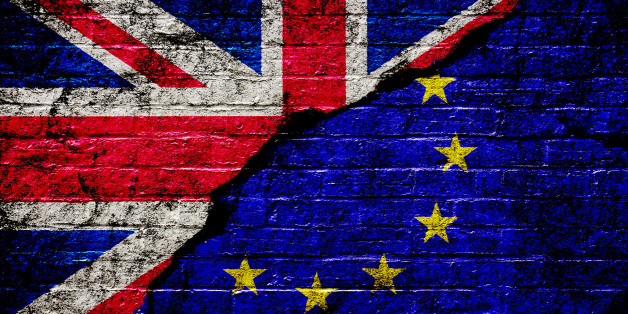 Brexit: Flags of the United Kingdom and the European Union painted onto a brick wall with a large crack