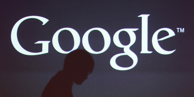 The shadow of a journalist is cast on a screen with the Google Inc. logo at a news conference in Seoul, South Korea, on Thursday, Sept. 27, 2012. Google Inc. will start selling its Nexus 7 tablet in South Korea on Oct. 7 to meet demand for mobile devices on the home turf of Samsung Electronics Co., the world's biggest seller of smartphones. Photographer: SeongJoon Cho/Bloomberg via Getty Images