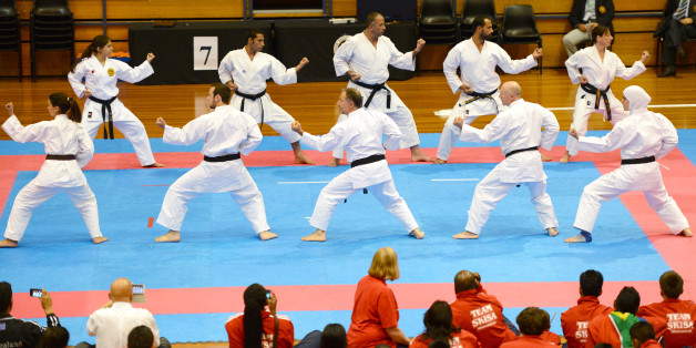 To go with 'Lifestyle-sports-karate-Mideast-Australia' by Madeleine CooreyThis picture taken on November 23, 2012 shows The Budo for Peace team giving a demonstration during the opening ceremony of the Shotokan Karate-do International Federation 11th World Championship, in Sydney. Taking its name from the Japanese expression for 'the way of stopping conflict', an organisation called Budo for Peace gave crowds at last month's Shotokan Karate-do International Federation world championships in Sydn