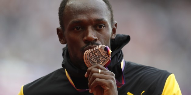 Athletics - World Athletics Championships – men's 100 metres victory ceremony – London Stadium, London, Britain – August 6, 2017 – Usain Bolt of Jamaica (Bronze) poses withthe medal. REUTERS/Matthew Childs
