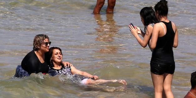 "Algerian women wear a ""burkini"" in the sea at the beach of Oran, West of Algiers on 5 August 2017. (Photo by Billal Bensalem/NurPhoto via Getty Images)"