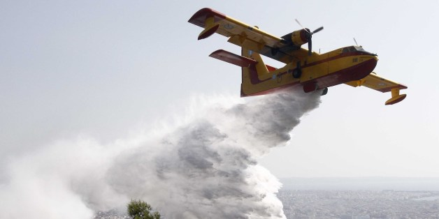 [UNVERIFIED CONTENT] GREECE,THESSALONIKI:A Canadair throws water to extinguish fire in Thessaloniki on August 26,2011