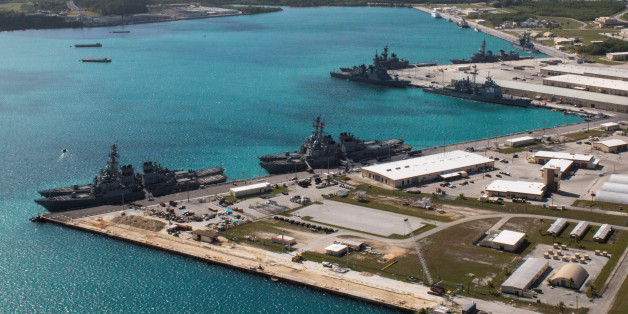 FILE PHOTO: Navy vessels are moored in port at the U.S. Naval Base Guam at Apra Harbor, Guam March 5, 2016.  Major Jeff Landis,USMC (Ret.)/Naval Base Guam/Handout/File Photo via REUTERS. ATTENTION EDITORS - THIS IMAGE WAS PROVIDED BY A THIRD PARTY