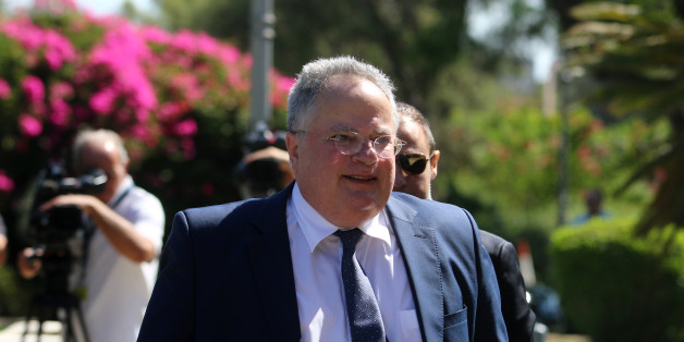 Greek Foreign Minister Nikos Kotzias arrives at the Presidential Palace in Nicosia, Cyprus July 18, 2017. REUTERS/Yiannis Kourtoglou