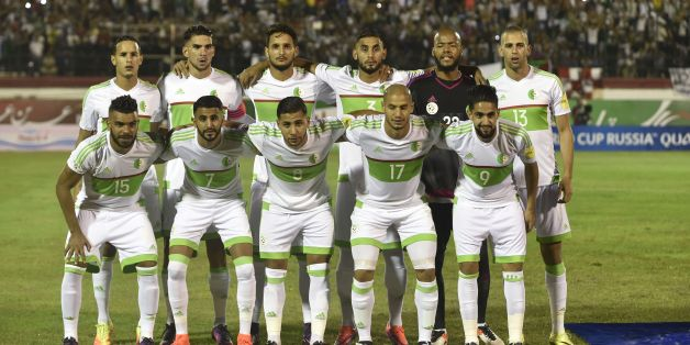 Algeria's national football team players (Front row from L) Hilal Soudani El Arabi, Karim Mahrez Riad, Taider Sliti Saphir, Aldane Guedioura, Ryad Boudebouz, (back row from L) Mehdi Zeffane, Carl Medjani, Liassine Cadamuro-Bentaiba, Faouzi Ghoulam, Rais M'Bolhi, Islam Slimani pose prior to the Fifa World Cup 2018 Africa qualifying football match between Algeria and Cameroon at the Mustapha Tchaker Stadium in Blida on October 9, 2016. / AFP / Ryad Kramdi        (Photo credit should read RYAD KRAM