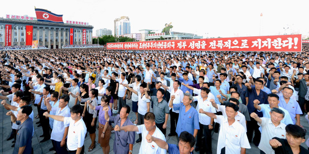 People participate in a Pyongyang city mass rally held at Kim Il Sung Square on August 9, 2017, to fully support the statement of the Democratic People's Republic of Korea (DPRK) government in this photo released on August 10, 2017 by North Korea's Korean Central News Agency (KCNA) in Pyongyang. KCNA/via REUTERS ATTENTION EDITORS - THIS IMAGE WAS PROVIDED BY A THIRD PARTY. REUTERS IS UNABLE TO INDEPENDENTLY VERIFY THIS IMAGE. NO THIRD PARTY SALES. SOUTH KOREA OUT. NO COMMERCIAL OR EDITORIAL SALES IN SOUTH KOREA.?
