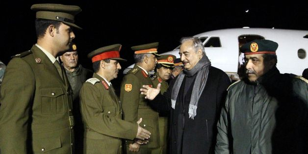 CORRECTION - Marshal Khalifa Haftar (2R), the military leader of the so-called Libyan National Army and Libyas parallel parliament based in the eastern city of Tobruk, is greeted upon his arrival at Al-Kharouba airport south of the town of al-Marj, about 80 km east of the Mediterranean port city of Benghazi on December 3, 2016 after his visit in Russia.  / AFP / Abdullah DOMA / The erroneous mention[s] appearing in the metadata of this photo by Abdullah DOMA has been modified in AFP systems in t