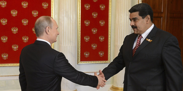 Russian President Vladimir Putin (L) shakes hands with Venezuela's President Nicolas Maduro during Putin's welcome reception for foreign delegations' heads and honorary guests in the Kremlin in Moscow, Russia, May 9, 2015. Russia marks the 70th anniversary of the end of World War Two in Europe on Saturday with a military parade, showcasing new military hardware at a time when relations with the West have hit lows not seen since the Cold War. REUTERS/Host Photo Agency/RIA Novosti ATTENTION EDITORS - THIS IMAGE HAS BEEN SUPPLIED BY A THIRD PARTY. IT IS DISTRIBUTED, EXACTLY AS RECEIVED BY REUTERS, AS A SERVICE TO CLIENTS