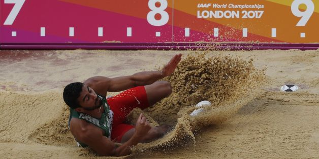 Algeria's Larbi Bourrada competes in the men's decathlon long jump athletics event at the 2017 IAAF World Championships at the London Stadium in London on August 11, 2017. / AFP PHOTO / Adrian DENNIS        (Photo credit should read ADRIAN DENNIS/AFP/Getty Images)