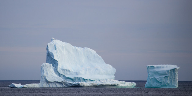FERRYLAND, NEWFOUNDLAND - APRIL 26: A large iceberg floats in the Atlantic Ocean, April 26, 2017 off the coast of Ferryland, Newfoundland, Canada. Icebergs break off from Baffin Island and Greenland every spring and drift down the stretch of water along the coast of Newfoundland and Labrador known as Iceberg Alley. According to media reports, the higher number of icebergs this season can be attributed to uncommonly strong counter-clockwise winds that draw the icebergs south and possibly global w
