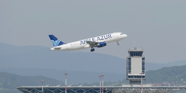 An Aigle Azur company airplane takes off from Mulhouse-Basel -Freiburg Euroairpot on June 19, 2013, in Saint-Louis (eastern France). AFP PHOTO / SEBASTIEN BOZON        (Photo credit should read SEBASTIEN BOZON/AFP/Getty Images)