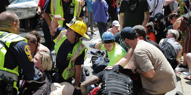 CHARLOTTESVILLE, VA - AUGUST 12:  Rescue workers and medics tend to many people who were injured when a car plowed through a crowd of anti-facist counter-demonstrators marching through the downtown shopping district August 12, 2017 in Charlottesville, Virginia. The car plowed through the crowed following the shutdown of the 'Unite the Right' rally by police after white nationalists, neo-Nazis and members of the 'alt-right' and counter-protesters clashed near Lee Park, where a statue of Confedera