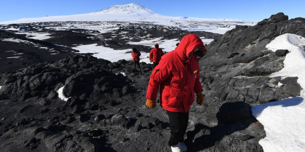 US Secretary of State John Kerry hikes in front of Mount Erebus after visiting the historic Shackleton hut near McMurdo Station during his visit to Antarctica on November 11, 2016. Kerry is travelling to Antarctica, New Zealand, Oman, the United Arab Emirates, Morocco and will attend the APEC summit in Peru later in the month. / AFP / POOL / MARK RALSTON        (Photo credit should read MARK RALSTON/AFP/Getty Images)