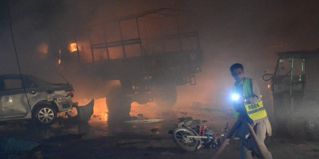 QUETTA,PAKISTAN-AUGUST 12: Fire fighters try to extinguigh a fire after powerful blast struck a military vehicle at a busy street in Quetta, the capital of southwestern Balochistan province, Pakistan on August 12, 2017. At least 15 people were killed and some 25 injured in an attack on an army vehicle in southwestern Pakistan on Saturday night, according to army officials and local media. (Photo by Mazhar Chandio/Anadolu Agency/Getty Images)