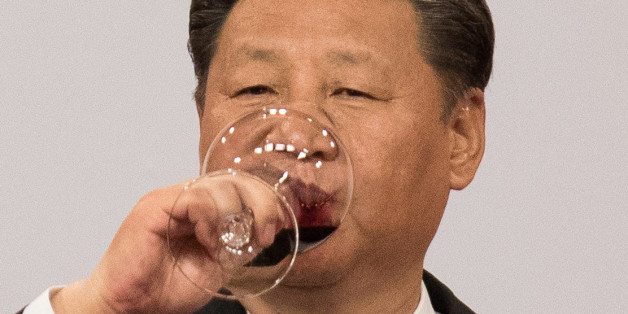 China's President Xi Jinping drinks wine as he makes a toast during a banquet in Hong Kong, China June 30, 2017. REUTERS/Dale de la Rey/Pool