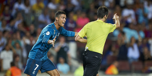 BARCELONA, SPAIN - AUGUST 13:  Cristiano Ronaldo (L) of Real Madrid reacts after a red card during the Supercopa de Espana Supercopa Final 1st Leg match between FC Barcelona and Real Madrid at Camp Nou on August 13, 2017 in Barcelona, Spain.  (Photo by fotopress/Getty Images)