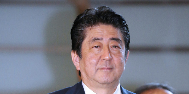 Japan's Prime Minister Shinzo Abe arrives at his official residence in Tokyo on August 15, 2017.Abe sent a cash donation to a controversial war shrine as the country marked the anniversary of its defeat in World War II. Yasukuni Shrine honours millions of mostly Japanese war dead, but is contentious for also enshrining senior military and political figures convicted of war crimes by an international tribunal. / AFP PHOTO / JIJI PRESS / STR / Japan OUT        (Photo credit should read STR/AFP/Get
