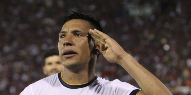 Andres Chavez of Argentina's Boca Juniors salutes after he scored against Paraguay's Cerro Porteno during the Copa Sudamericana 2014 quarterfinals second leg soccer match in Asuncion November 6, 2014.             REUTERS/Jorge Adorno (PARAGUAY - Tags: SPORT SOCCER)