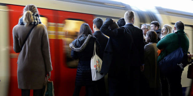 Commuters wait on the platform as a tube arrives on the London Underground, Britain November 16, 2016.    REUTERS/Kevin Coombs