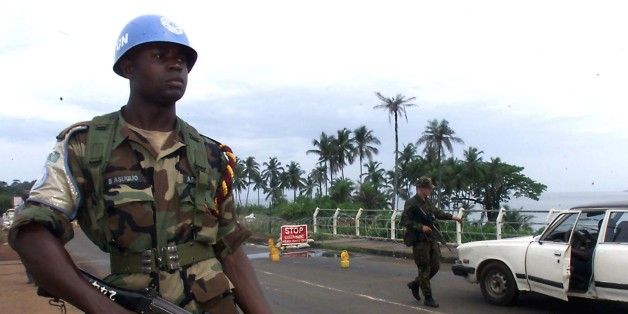 Nigerian United Nations peacekeeper guards a joint check-point with a Royal Marine Commando in Freetown May 30. The United Nations said on Tuesday it had urged Siera Leone's rebels to allow free movement to 258 peacekeepers they have surrounded in the bush for about four weeks.
