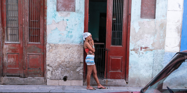 A young lady seen near her house entrance in Havana city center. 