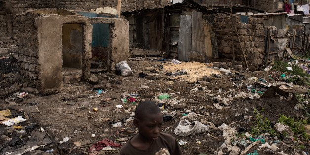 NAIROBI, KENYA - AUGUST 14: A boy walks through homes that were burned in unrest two days prior in the Mathare North neighborhood on August 14, 2017 in Nairobi, Kenya. Nairobi remained peaceful, but tensions remain high as oppositions supporters wait to hear from candidate Raila Odinga who has rejected the results that named Uhuru Kenyatta to his second term in Kenya's 2017 presidential election. (Photo by Andrew Renneisen/Getty Images)