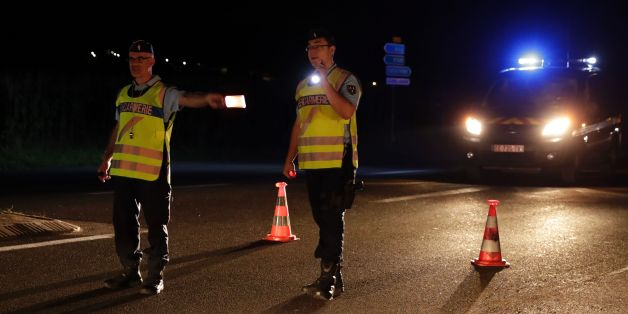 Police officers direct traffic on a road near the site where man smashed a car into a pizza restaurant in Sept-Sorts, 55km east of Paris, on August 14, 2017, killing a 13-year-old girl and seriously injuring four. Investigators said the young driver had tried to commit suicide and the incident was not terror-related. The man, who was arrested, said 'he had tried to kill himself yesterday (August 13) without success and decided to try again this way,' a source close to the inquiry said. / AFP PHOTO / Thomas Samson        (Photo credit should read THOMAS SAMSON/AFP/Getty Images)