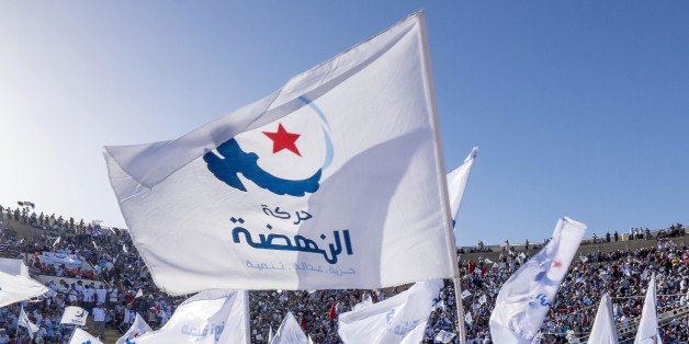 In October 18th, 2014: in the theater of Sidi Mansour, city in the suburb of Sfax, the second city of the country, more than 10 000 partisans of Ennahdha gathered for a big meeting of the Islamist party. Under a blazing sun, Rached Ghannouchi, president of the party, orchestrates an electoral meeting with presentations of both lists Ennahdha (Sfax1 and 2), talk about candidates and final speech of Ghannouchi. (Photo by Nicolas Fauqu��/Corbis via Getty Images)
