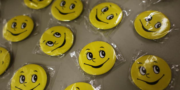 Badges for participants of a Laughter Yoga class are displayed before a exercise for the staff at Ocean Park in Hong Kong July 10, 2014. Consultancy firm ?Inspire 2 Aspire? run Laughter Yoga classes for corporations which partner Mahesh Pamnani believes ease stress and increases productivity and creativity among staff. Laughter Yoga was first developed 1995 in Mumbai, India by Dr. Madan Kataria, and has over 600 clubs in 60 countries, according to Laughter Yoga International.  REUTERS/Bobby Yip