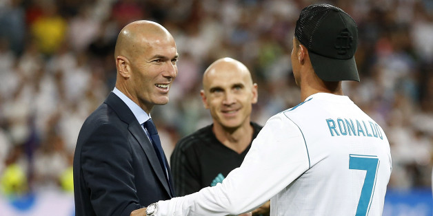 MADRID, SPAIN - AUGUST 16: Head coach Zinedine Zidane (L) and Cristiano Ronaldo of Real Madrid celebrate after the Supercopa de Espana Final second leg match between Real Madrid and FC Barcelona at Estadio Santiago Bernabeu on August 16, 2017 in Madrid, Spain. (Photo by Angel Martinez/Real Madrid via Getty Images)