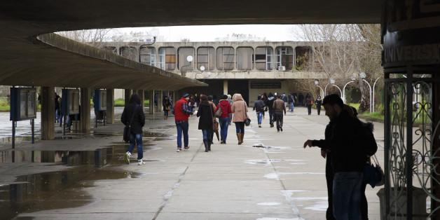 ALGIERS, ALGERIA - JANUARY 25: Students walk across campus of University of Sciences and Technology Houari Boumediene in January 25, 2015 in Algiers, Algeria.  (Photo by Thomas Trutschel/Photothek via Getty Images)