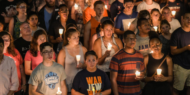 CHARLOTTESVILLE, VA - AUGUST 16: Hundreds of people march peacefully with lit candles across the University of Virginia campus on Wednesday, August 116, 2017, in Charlottesville, VA, in the wake of violence in the city and against torch-lit white nationalist parade the same campus last Friday night. (Photo by Salwan Georges/The Washington Post via Getty Images)