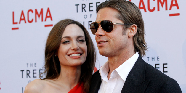 """Cast member Brad Pitt and actress Angelina Jolie pose at the premiere of """"The Tree of Life"""" at LACMA in Los Angeles May 24, 2011. REUTERS/Mario Anzuoni/File Photo"""