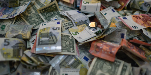 A view Euro and Dollar billets and coins, on March 20, 2017, in Dublin, Ireland. White House press secretary Sean Spicer said in his interview with the Sunday Independent: 'As much as we love Ireland... we want the US companies back'. (Photo by Artur Widak/NurPhoto via Getty Images)