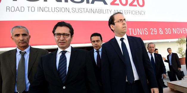 Tunisian Prime Minister Youssef Chahed (R) and Tunisia's Investment and International Cooperation Minister Fadhel Abdelkefi (C) arrive to inspect the final preparation at the Congress Palace in the capital Tunis, on November 27, 2016, two days ahead of the opening ceremony of the 'Tunisia 2020' conference.
