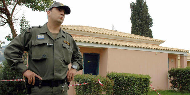 Gouvia, GREECE:  A Greek policeman guards the bungalow of the Corcyra hotel where the two British children were found dead Thursday, on 28 October 2006. A carbon monoxide leak has been blamed for the death of the two British children found beside their comatose father and his female companion in the hotel bungalow on the Greek Ionian Sea island of Corfu, a coroner said on Saturday. AFP PHOTO /DIMITRA LOUVROU  (Photo credit should read Dimitra Louvrou/AFP/Getty Images)