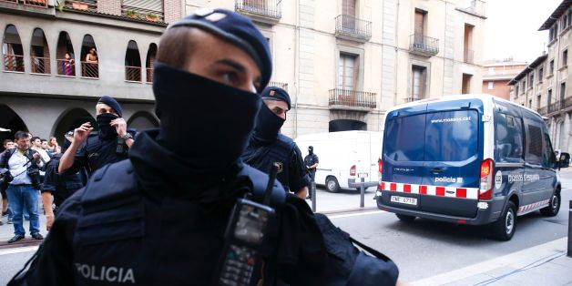Catalan autonomous police officers, known as Mosso d'Esquadra, block a road after detaining a suspect in Ripoll following a search linked to the deadly terror attacks in Barcelona and the seaside resort of Cambrils, a day after a van ploughed into the crowd, killing 14 persons and injuring over 100 on the Rambla in Barcelona. Drivers have ploughed on August 17, 2017 into pedestrians in two quick-succession, separate attacks in Barcelona and another popular Spanish seaside city, leaving 14 people dead and injuring more than 100 others. / AFP PHOTO / PAU BARRENA        (Photo credit should read PAU BARRENA/AFP/Getty Images)