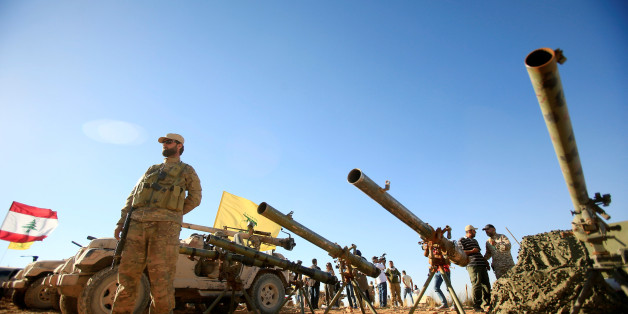 A Hezbollah fighter stands in front of anti-tank artillery at Juroud Arsal, the Syria-Lebanon border, July 29, 2017. REUTERS/Ali Hashisho     TPX IMAGES OF THE DAY
